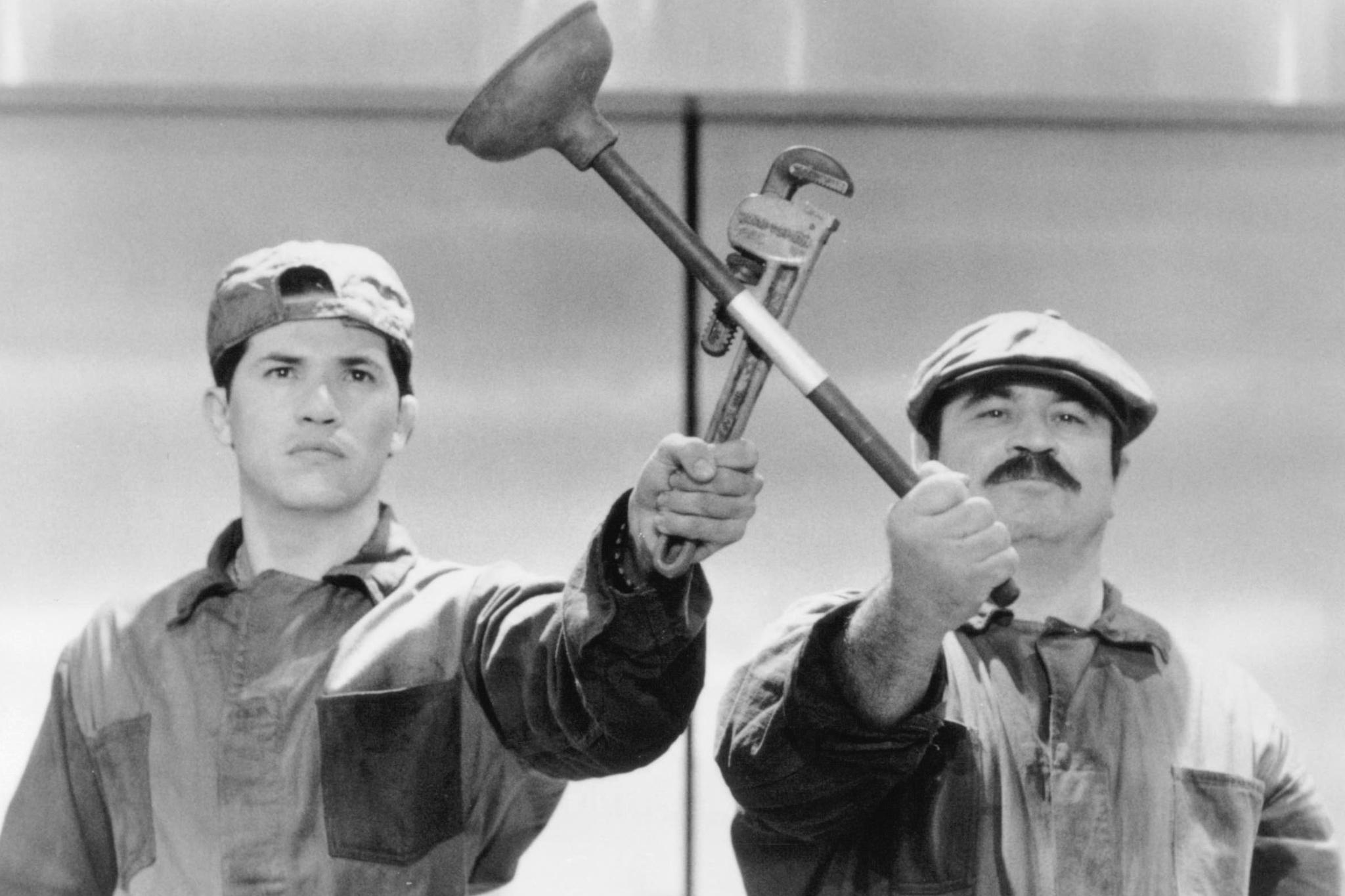 still-of-john-leguizamo-and-bob-hoskins-in-super-mario-bros.-(1993)